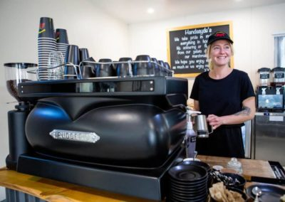 Smiling young woman making you a coffee