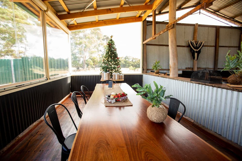A long table in the hay barn