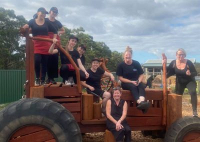 The cafe staff on a playground tractor